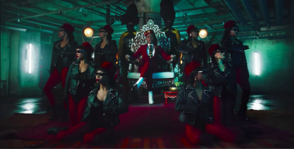 Janelle Monae on a throne surrounded by people